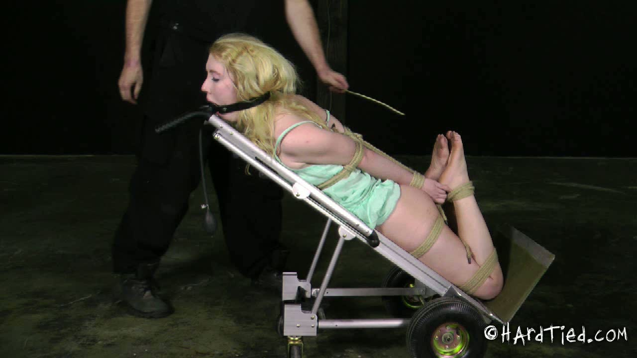Slender pale auburn chick in light blue dress is fucked with toy in BDSM mode