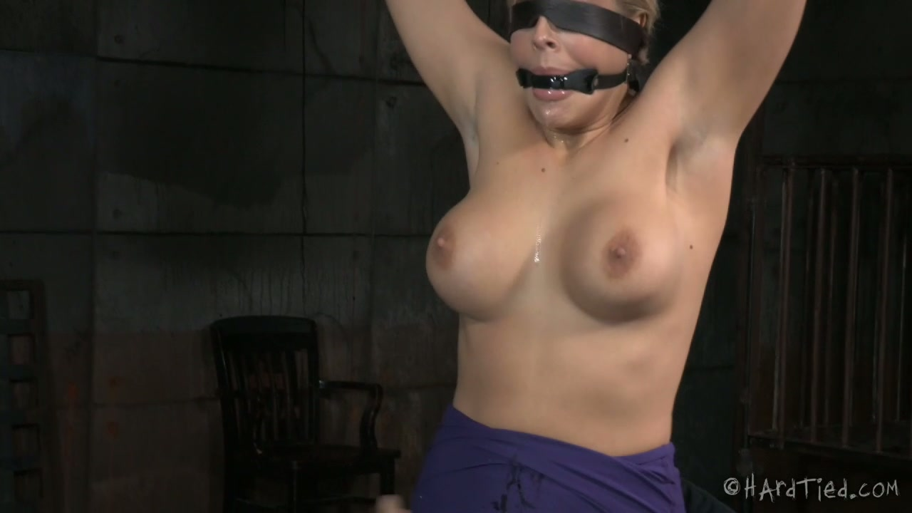 Oiled up whore is getting her body stretched in BDSM porn video